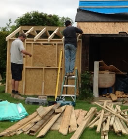 small wooden shed being constructed